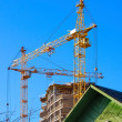 Stock Photo: Two tower cranes building
