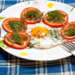 Plate with fried egg and tomatoes — Stock Photo