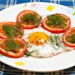 Plate with fried egg and tomatoes — Stock Photo #11381018