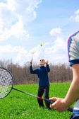 Family - two little boys playing badminton — ストック写真