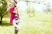 Girl on the tree — Stock Photo