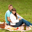 Young couple in love on a romantic picnic — Stock Photo