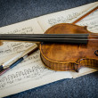 Wooden violin and bow — Stock Photo