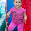 A little girl jumping on a trampoline — Stock Photo
