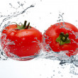 Royalty-Free Stock Photo: Tomatoes in a spray of water