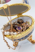 Jewelry egg with gold ornaments — Stock Photo