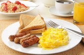 Hearty sausage and egg breakfast — Stock Photo