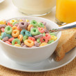 Rings of fruit flavored breakfast cereal — Stock Photo
