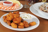 Breaded calamari with tarter sauce — Stock Photo