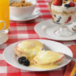 Eggs Benedict with Fruit Cocktail — Stock Photo #11011000