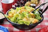 Garden salad on a picnic table — Stock Photo