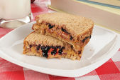 Sandwich and schoolbooks — Stock Photo