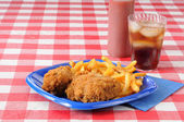 Fried chicken on a picnic table with copyspace — Stock Photo