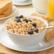 Breakfast cereal with blueberries and toast — Stock Photo