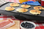 Hotcakes cooking on the griddle — Stock Photo