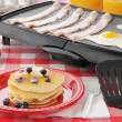Stock Photo: Hearty breakfast cooking on grill