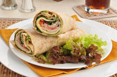 Turkey wraps on a bed of lettuce — Stock Photo
