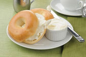 Sliced bagels with cream cheese — Stock Photo