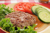 Grilled ground beef patty with vegetables — Stock Photo