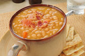 Bean with bacon soup with crackers — Stock Photo