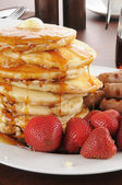 Tall stack of homemade pancakes — Stock Photo