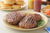 Grilled hamburgers — Stock Photo
