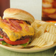 Bacon cheeseburger with a soft drink — Stock Photo