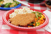Chicken fried steak on a picnic table — Stock Photo