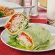 Turkey club sandwich wrapped in a spinach tortilla - Photo