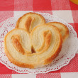 Petite Palmiers on a doilie — Stock Photo