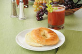 Toasted bagel with a bloody mary cocktail — Stock Photo