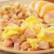 Scrambled eggs with diced ham — Stock Photo