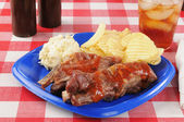 Pork ribs and coleslaw — Stock Photo