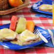 Eggs Benedict with fresh melon slices — Stock Photo