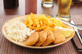 Fish sticks with coleslaw — Stock Photo