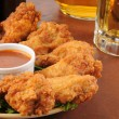 Stock Photo: Chicken wings and beer