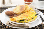 Spinach omelet with sausage — Stock Photo