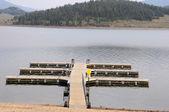 Boat dock at a mountain lake — Stock Photo