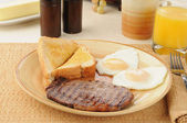 Steak and eggs — Stock Photo