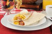 Breakfast burrito and fruit — Stock Photo
