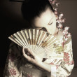 Geisha with fan — Stock Photo