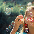 Little Girl Blowing Soap Bubbles — Stock Photo #11805500