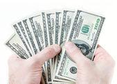 долларов банкноты в мужских руках — Стоковое фото