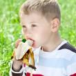 Boy eating banana — Stock Photo