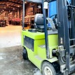 Forklift at large warehouse — Stock Photo