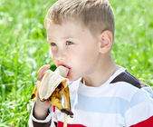 Boy eating banana — Stock Photo
