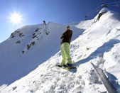 Snowboarder in mountains of the Caucasus — Стоковое фото