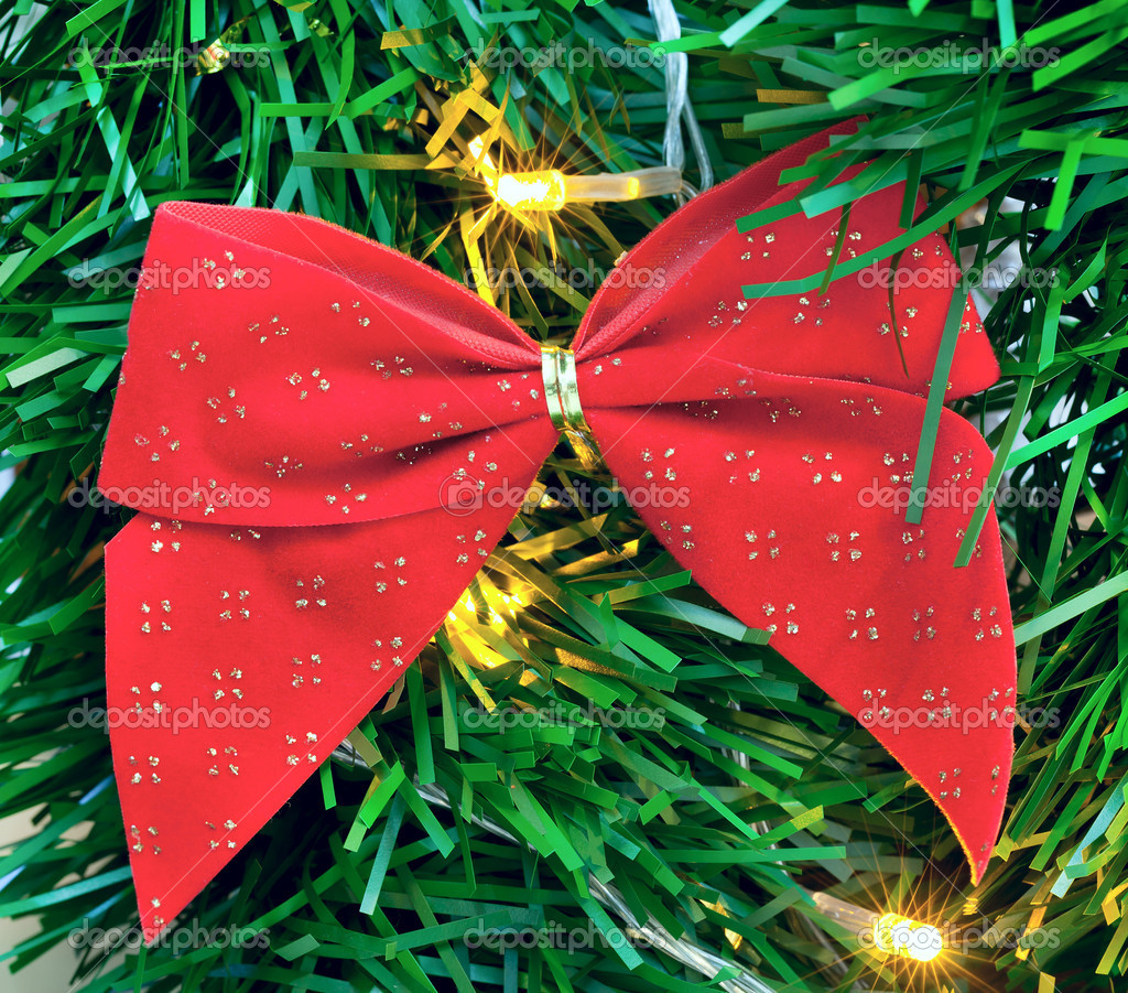 Red bow on Christmas tree — Stock Photo #11036280