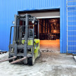 Stok fotoğraf: Forklift at large warehouse