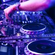 Stock Photo: Dj mixes track